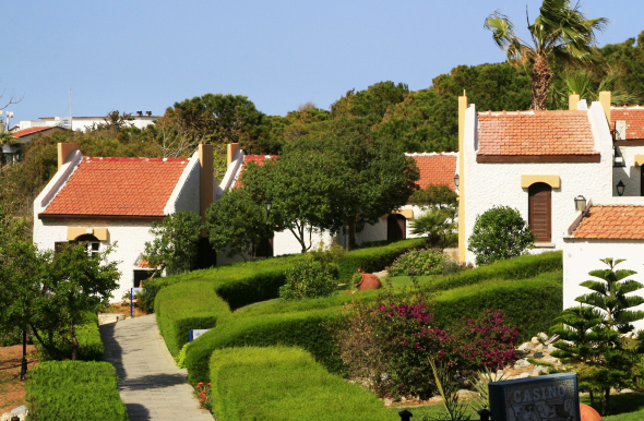 The bungalows are set on a palette of lush gardens